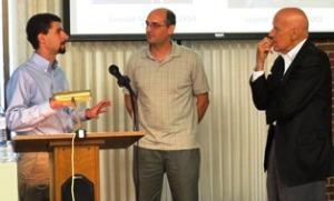 Dr. Alan Barenberg explains details of the Gulag system to REEEC Director Dr. David Cooper and community member Mr. Bob Paige
