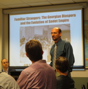 Dr. Erik Scott (seated to the far left) and Professor David Cooper (standing).