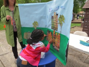 Headstart student helping create a photo booth background.
