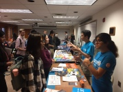 Students visiting the resource tables and networking