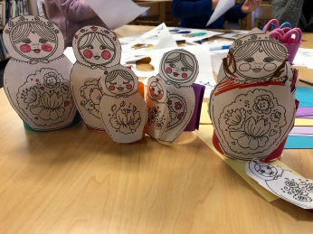Students made their own matryoshka dolls by coloring and cutting out the doll, and attaching a ring of construction paper to allow them to stand and nest inside of each other.